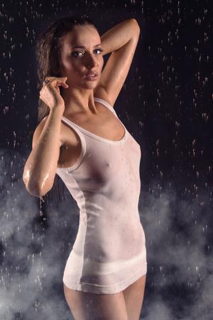 Sexy beautiful woman posing in white shirt under water