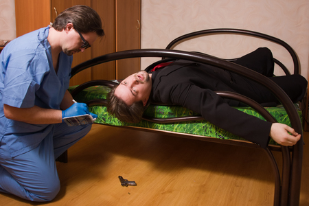 forensic: Crime scene with forensic investigating a crime on a businessman Stock Photo