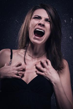 Asylum. Screaming crazy woman. Low key.