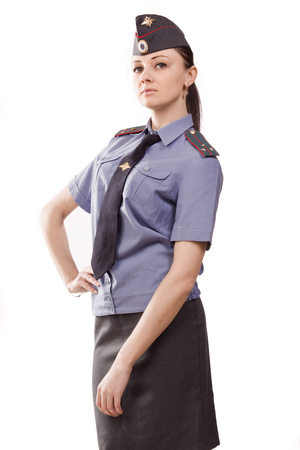Russian woman police officer in uniform over white