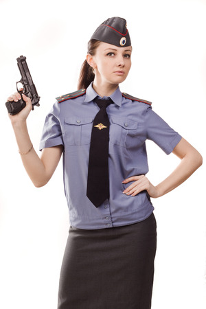 Woman police officer with gun