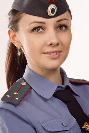 Russo donna agente di polizia in uniforme su bianco Archivio Fotografico - 39237354