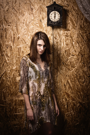 sanitarium: Asylum. Lonely mad woman in a dark room. Low key.