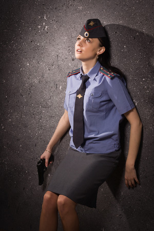 female police: Criminal. Police woman shot in the head Stock Photo