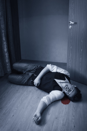 swooned: Dead man lays on a floor Stock Photo