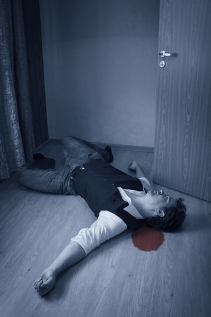 murder scene: Dead man lays on a floor Stock Photo