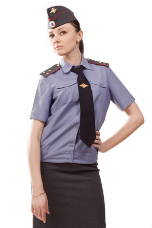 youth crime: Russian woman police officer in uniform over white
