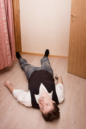 lifeless: Lifeless man lays on a floor