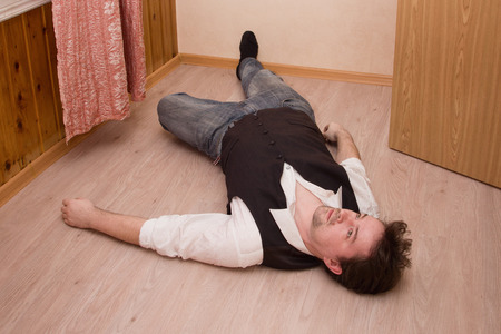 corpse: Dead man lays on a floor Stock Photo