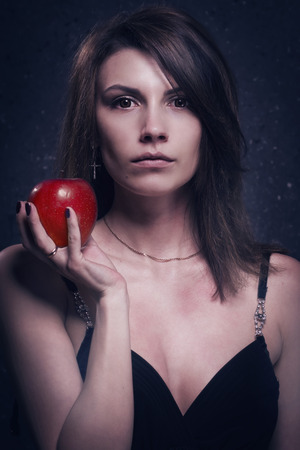 asylum: Asylum. Lonely mad woman with red apple. Low key. Stock Photo