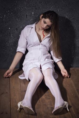 Crime scene. Dead nurse lying on the floor