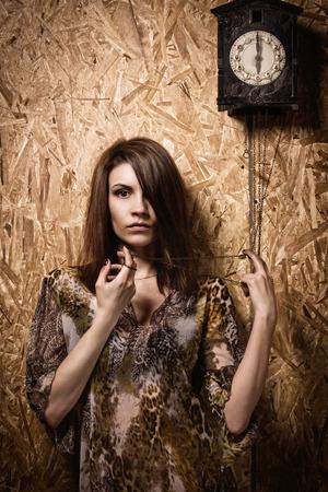 Asylum. Lonely mad woman in a dark room. Low key.