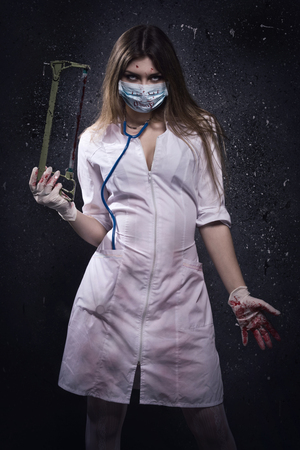 Crazy bloody nurse in a dark room