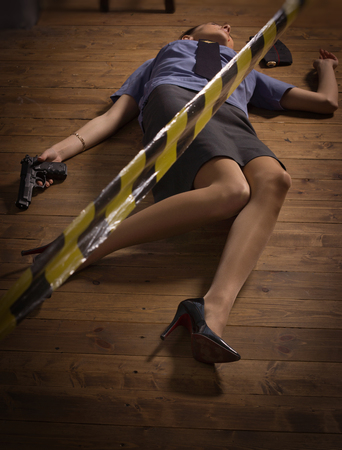 murder scene: Crime scene imitation. Woman police officer lying on a floor