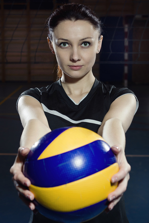 female volleyball: Female volleyball player with a ball. Low key Stock Photo
