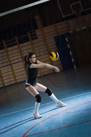 female volleyball: Female volleyball player. Low key Stock Photo