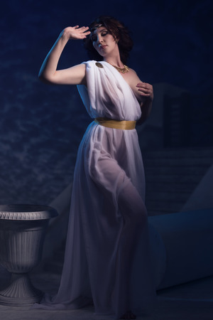 toga: Ancient godness in a white greece toga on a temple ruins background. Night lights.
