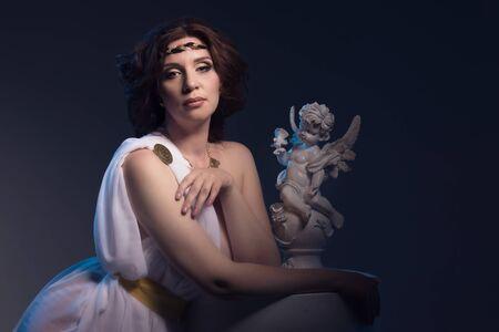 toga: Beautiful Woman Wearing White Greek Toga in a dark antique interior