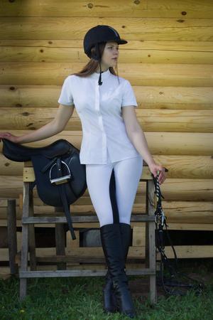 jockey: Beautiful girl jockey posing outdoors