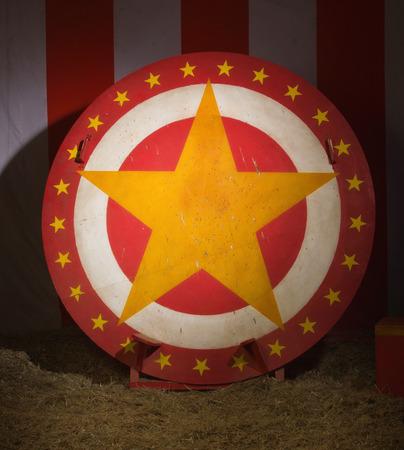 Circular disc with star in a retro circus