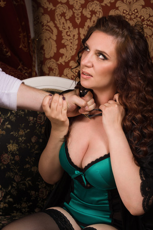 adult rape: Close up of sexual woman being strangled Stock Photo