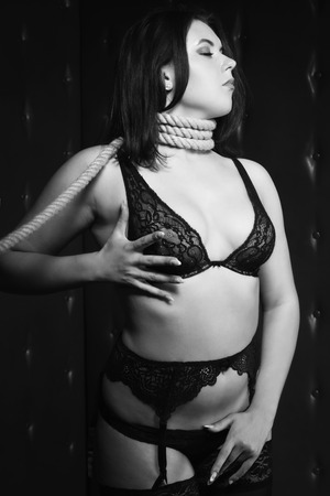 brunette with the noose around her neck. Black and white image, low key