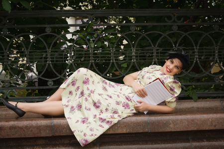 music book: Very beautiful soviet girl in retro style with a music book.