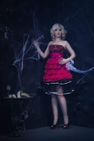 dark interior: Beautiful woman broken doll in dark interior