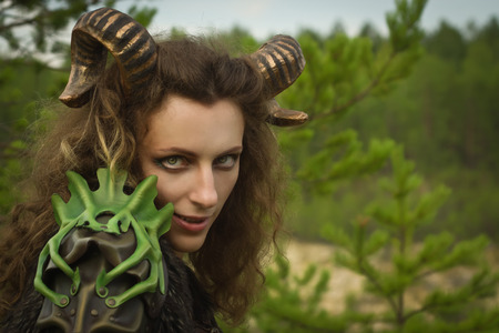 faun: Portrait of the pretty female faun in a wood. Mythological creature in a forest