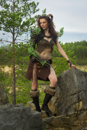 woodwind: Pretty female faun in a wood. Mythological creature in a forest Stock Photo