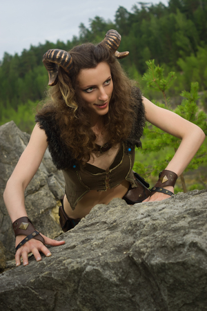 mythological: Pretty female faun in a wood. Mythological creature in a forest Stock Photo