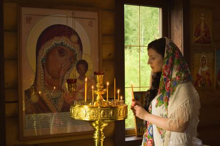 the orthodox church: Russian woman with candles in Orthodox Russian Church