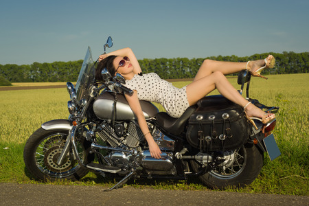 Sexy caucasian woman on motorcycle Stock Photo