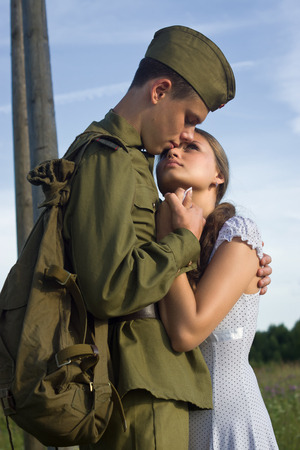 army soldier: Soviet soldier in uniform of World War II saying goodbye to girl