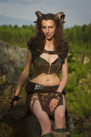 faun: Pretty female faun in a wood. Mythological creature in a forest Stock Photo