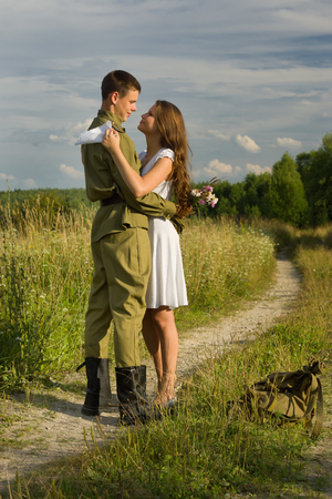 girl fight: Happy girl meets a soldier. Return of the Soviet soldier in uniform of World War II home