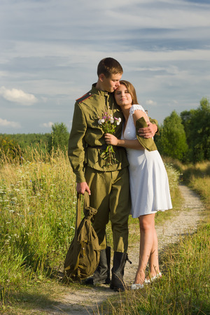 meets: Happy girl meets a soldier. Return of the Soviet soldier in uniform of World War II home