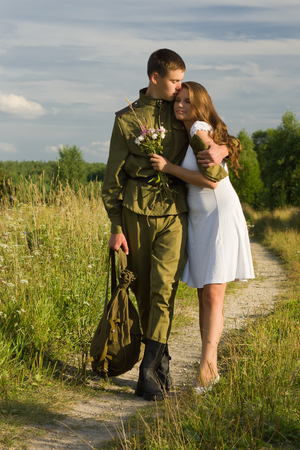 Happy girl meets a soldier. Return of the Soviet soldier in uniform of World War II home