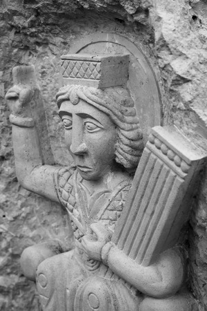 psalm: David the Psalmist. Stone carving in the old Russian style Stock Photo