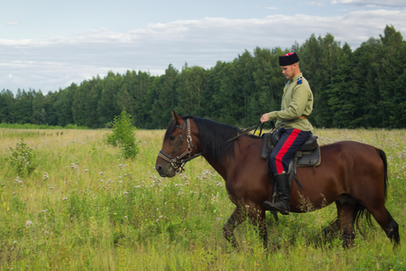 cavalryman: Russian Cossack uniformed WWI inspecting the border on horseback