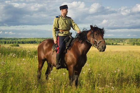 drover: Russian Cossack uniformed WWI inspecting the border on horseback