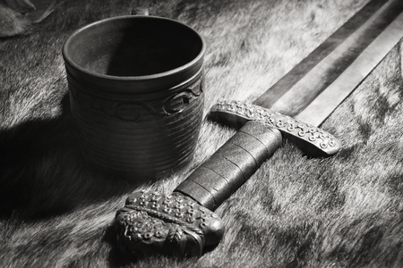 viking: Still life with the viking sword and stein on a fur