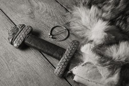 karoling: Still life with scandinavian sword on a fur Stock Photo
