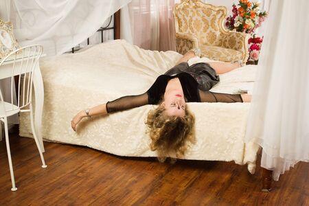 strangled: Crime scene simulation. Lifeless woman lying on a bed