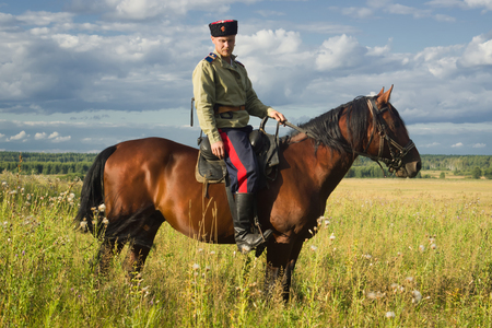archival: Russian Cossack uniformed WWI inspecting the border on horseback