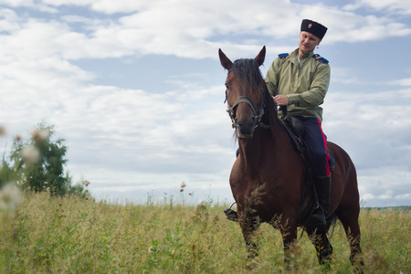 sabre: Russian Cossack uniformed WWI inspecting the border on horseback