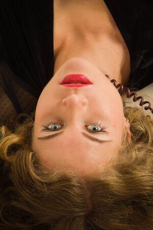 strangled: Crime scene simulation. Strangled woman lying on sofa