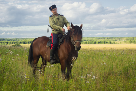 cossack: Russian Cossack uniformed WWI inspecting the border on horseback