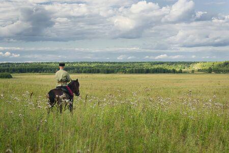 cavalryman: Russian Cossack uniformed WWI inspecting the border on horseback