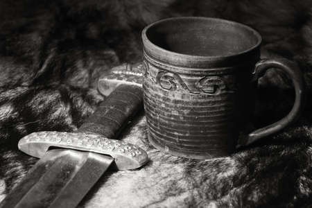 karoling: Still life with the viking sword and stein on a fur